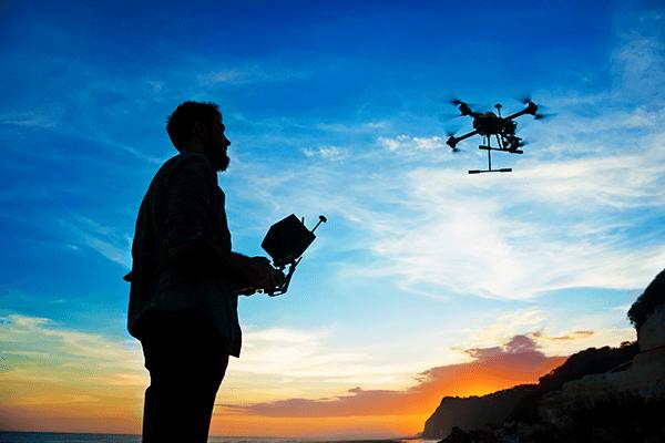 Man flies a drone outside
