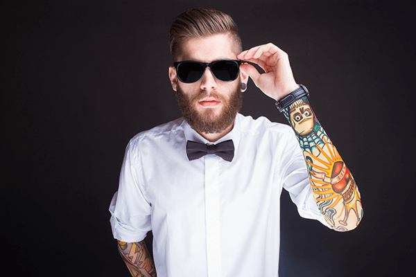 Man with sunglasses and tattoo sleeves