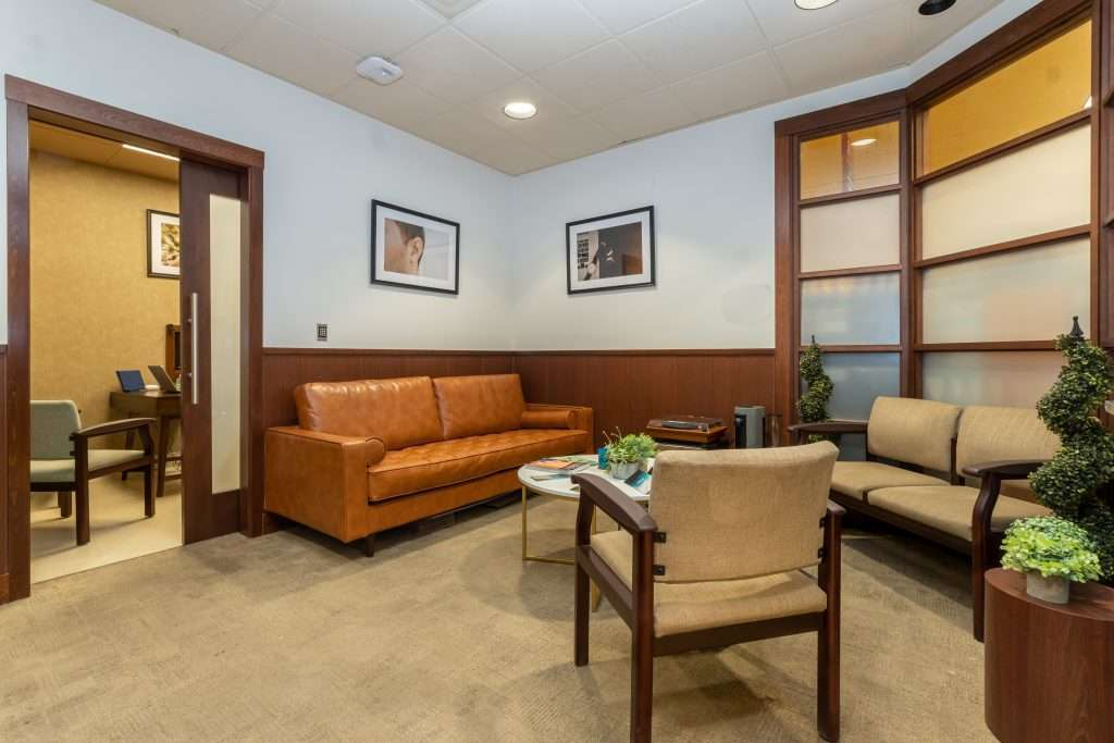the waiting room for the Audicus hearing clinic in Lone Tree Colorado is comfortable for every patient