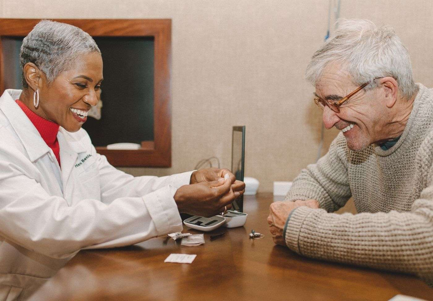 Audiologist helps a patient in the Lone Tree Denver clinic